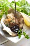 Balsamic vinegar over oyster au gratin Stock Photo