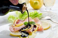 Balsamic vinegar over swordfish carpaccio stock photo