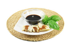 Balsamic vinegar, Parmesan and basil Stock Image