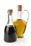 Balsemieke azijn en olijfolie stock foto