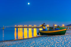 Baltic beach with fishing boat at night Royalty Free Stock Image