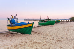 Baltic beach with fishing boat at sunset Royalty Free Stock Images