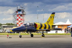 Baltic Bees Jet Team with Aero L-39 Albatros planes standing on a runway. HRADEC KRALOVE, CZECH REPUBLIC - SEPTEMBER 5: Baltic Bees Jet Team with Aero L-39 Stock Photography