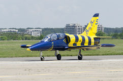 Baltic Bees plane taxiing. An aircraft belonging to Baltic Bees aerobatic team taxiing on the runway at BIAS 2014, an air show event held on 22 June 2014 in Royalty Free Stock Photography