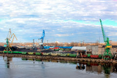 Baltic coal terminal. With port cranes near the river royalty free stock image