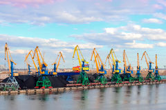Baltic coal terminal. With port cranes near the river royalty free stock photo