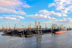 Baltic coal terminal. With port cranes near the river Stock Images