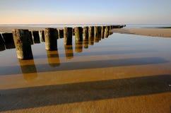 Baltic coast at sunset, breakwater, beach, Kolobrzeg, Poland. royalty free stock photos