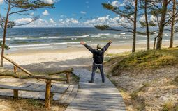Happy senior tourist is resting near a beach of the Baltic Sea Royalty Free Stock Image