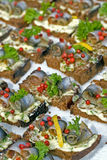 Baltic herring on slices of bread. 