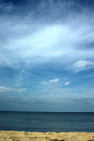 Baltic open waters with blue sky. Dramatic clouds over Baltic Sea with gold sand Stock Photography