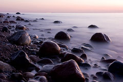 Baltic sea. And dark stones Royalty Free Stock Photography