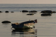 Baltic Sea beach  with boats in sunset Royalty Free Stock Photo