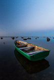 Baltic Sea beach  with boats in sunset Royalty Free Stock Photos