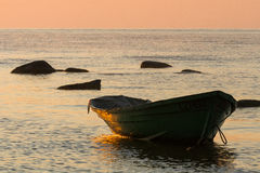 Baltic Sea beach  with boats in sunset Stock Photo