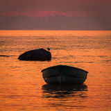Baltic Sea beach  with boats in sunset Royalty Free Stock Photography