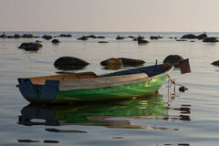 Baltic Sea beach  with boats in sunset Stock Photography