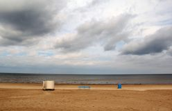 Baltic sea beach. empty beach. Baltic sea beach. not swimming season. Central European holidays. empty beach with changing room and trash can stock image