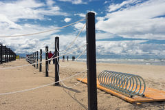 Baltic Sea beach with fencing and parking for bicycles Stock Photos