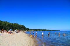 Baltic sea beach at Kulikovo on a hot July day. KULIKOVO, RUSSIA — JULY 19, 2014: Baltic sea beach at Kulikovo on a hot July day Royalty Free Stock Photos