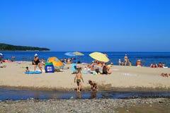 Baltic sea beach at Kulikovo on a hot July day. KULIKOVO, RUSSIA — JULY 19, 2014: Baltic sea beach at Kulikovo on a hot July day Stock Photography