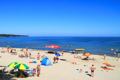 Baltic sea beach at Kulikovo on a hot July day. KULIKOVO, RUSSIA — JULY 19, 2014: Baltic sea beach at Kulikovo on a hot July day Stock Images