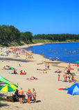 Baltic sea beach at Kulikovo on a hot July day. KULIKOVO, RUSSIA — JULY 19, 2014: Baltic sea beach at Kulikovo on a hot July day Royalty Free Stock Photography