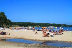Baltic sea beach at Kulikovo on a hot July day. KULIKOVO, RUSSIA — JULY 19, 2014: Baltic sea beach at Kulikovo on a hot July day Stock Photo