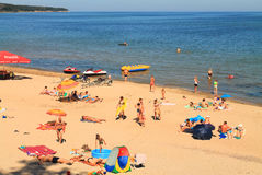 Baltic sea beach at Kulikovo on a hot July day. KULIKOVO, RUSSIA — JULY 19, 2014: Baltic sea beach at Kulikovo on a hot July day Stock Image