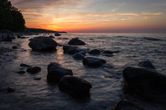 Baltic Sea beach  with stones in sunset Royalty Free Stock Photos