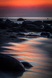 Baltic Sea beach  with stones in sunset Stock Photography