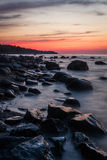 Baltic Sea beach  with stones in sunset Stock Photos
