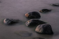 Baltic Sea beach  with stones in sunset Royalty Free Stock Images