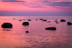 Baltic Sea beach  with stones in sunset Royalty Free Stock Photo
