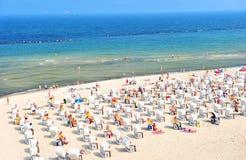 Baltic Sea beach tourists sunbeds umbrellas Travel background. Baltic Sea beach with tourists, sunbeds and umbrellas. Travel background stock photos