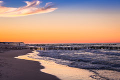 Baltic sea at beautiful sunrise in Poland beach. Royalty Free Stock Photo