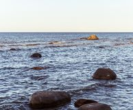 The Baltic Sea with big stones in the water royalty free stock photography