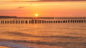 Baltic Sea, breakwaters and dramatic sky stock video