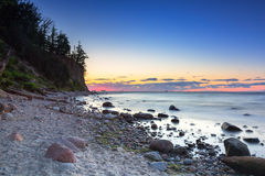 Baltic sea and Cliff of Orlowo at sunrise Stock Photo
