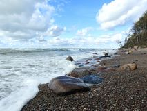 Baltic sea coast, beautiful clouds and stones, Lithuania stock photography
