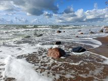 Baltic sea coast, beautiful clouds and stones, Lithuania royalty free stock images
