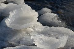 Frozen, icy Baltic Sea coast 21. Baltic Sea coast covered with a lot of shining ice cubes like diamonds on the sand and water surface. Waves are frozen in the royalty free stock images