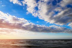 Baltic sea coast with scenic cumulus and stratocumulus clouds on the sky at sunset. Picturesque summer seascape. Pomerania, Gdansk bay, northern Poland stock photos
