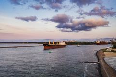 Cargo ship leaving the port, northern Poland. stock images