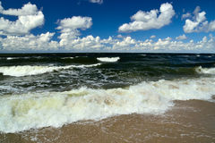Baltic sea and cumulus clouds Stock Photo