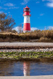 Baltic sea dunes lighthouse in red and white Stock Photo