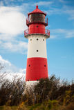 Baltic sea dunes lighthouse in red and white Royalty Free Stock Photos
