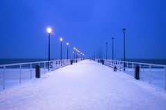 Snowy pier at Baltic Sea in Gdansk. Baltic Sea pier in Gdansk at dusk, Poland Royalty Free Stock Photo