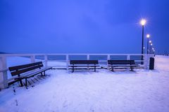 Snowy pier at Baltic Sea in Gdansk. Baltic Sea pier in Gdansk at dusk, Poland Royalty Free Stock Image