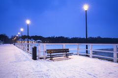Snowy pier at Baltic Sea in Gdansk. Baltic Sea pier in Gdansk at dusk, Poland Royalty Free Stock Photos